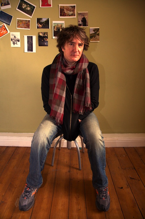 Colour photograph of Dylan Moran on chair