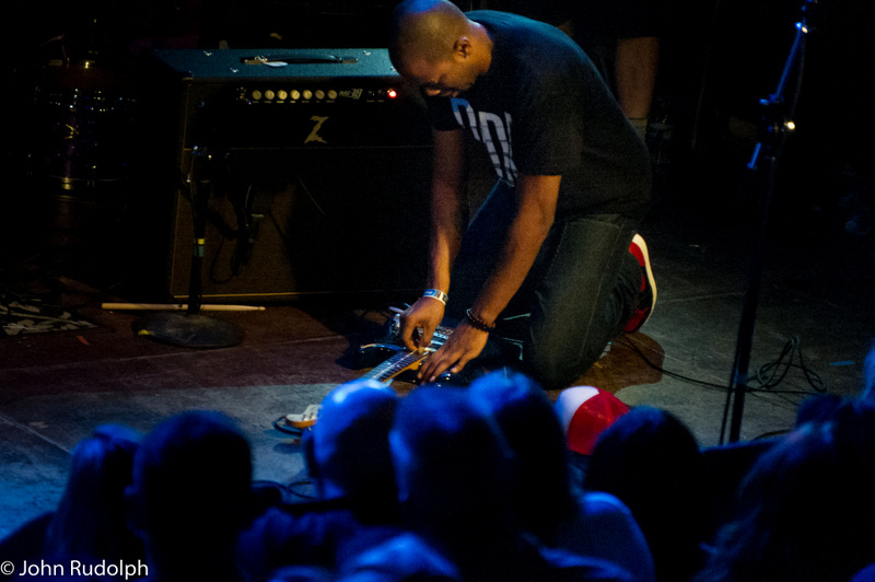 Ayron Jones Beating His Guitar (1 of 1)